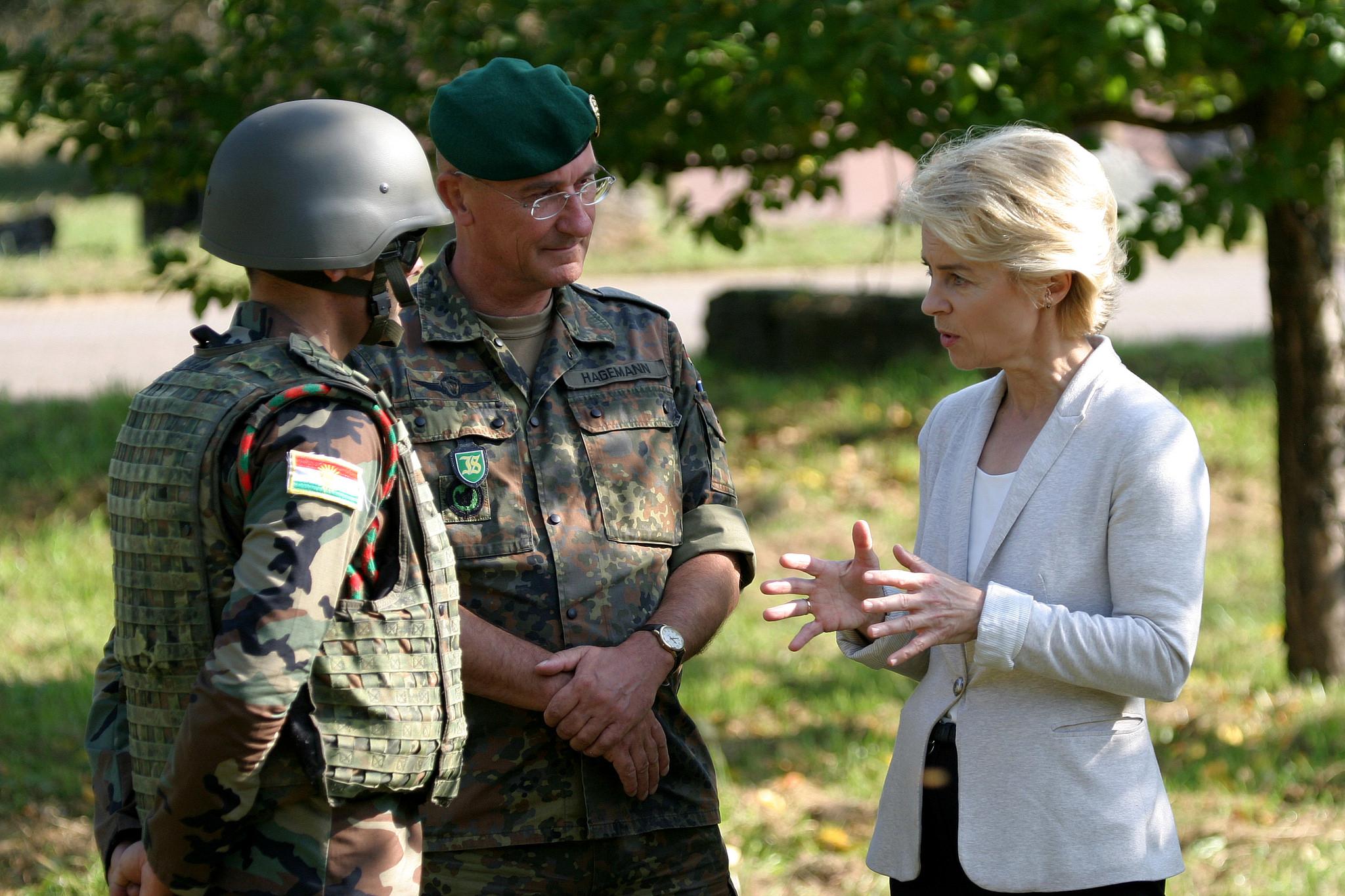 German Defense Minister Ursula von der Leyen speaks with German troops during a training exercise on 2 October, 2014. [Medien Bundeswehr/Flickr]