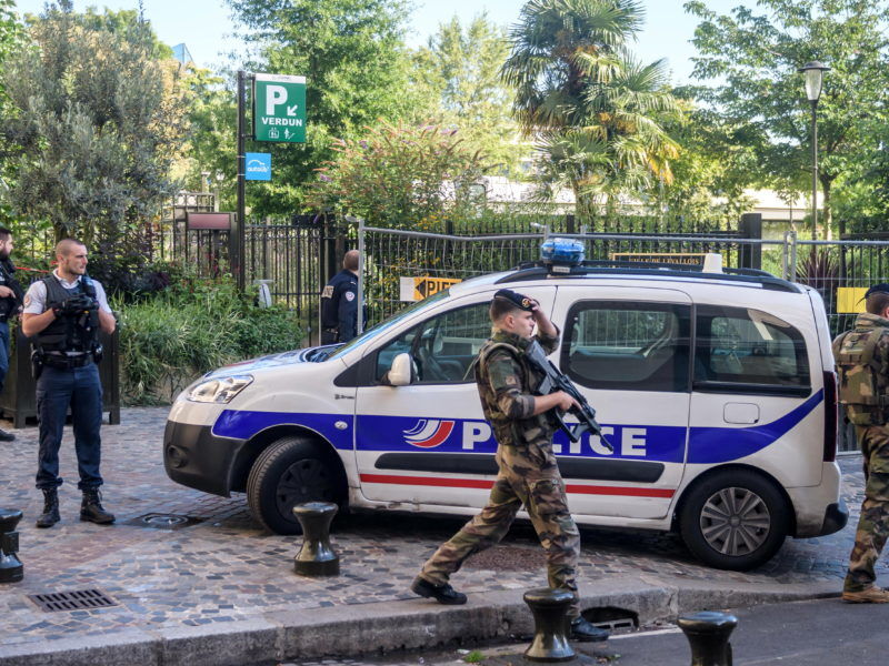 epa06133276 Police and military officers set up a security perimeter near the site where six soldiers of the anti-terrorism Sentinelle operation were hit by a car in Levallois-Perret, near Paris, France, 09 August 2017. According to media reports, six soldiers were injured, two seriously, in what is being described as a 'deliberate attack' by Levallois-Perret mayor Patrick Balkany. A manhunt is underway for the perpetrator of the attack.. EPA/CHRISTOPHE PETIT TESSON